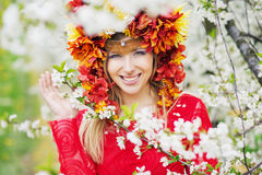 Beautiful woman with the colorful flowery hat Stock Photos