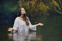 Beautiful woman in colorful forest stream royalty free stock photo