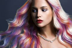 Beautiful woman with Colorful hair and Jewelry. Rainbow Hairstyles. Beauty Fashion Model with Colorful Dyed Hair stock photos