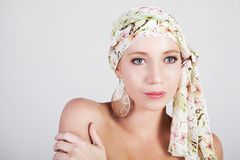 Beautiful Woman in a Colorful Headscarf Stock Photography