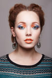 Beautiful woman with colorful make-up. Beauty girl with braids hairstyle. beautiful young woman with colorful make-up Royalty Free Stock Photo