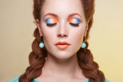Beautiful woman with colorful make-up. Beauty girl with braids hairstyle. beautiful young woman with colorful make-up Stock Photo