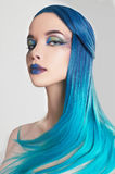 Beautiful woman with colorful make-up and blue hair. Cristals and drawing on face Royalty Free Stock Photography