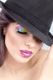 Beautiful woman,colorful make up. Beautiful woman with hat and colorful make up Royalty Free Stock Photos