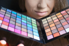 Beautiful woman with colorful palette for fashion makeup Stock Photos