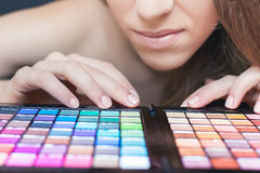 Beautiful woman with colorful palette for fashion makeup Royalty Free Stock Images