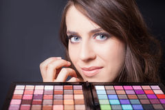 Beautiful woman with colorful palette for fashion makeup Stock Images