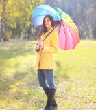Beautiful woman with colorful umbrella outdoors in autumn Stock Image