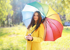 Beautiful woman with colorful umbrella, pretty girl posing. In autumn day Royalty Free Stock Photography