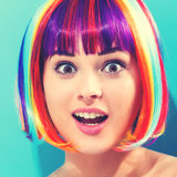 Beautiful woman in a colorful wig Royalty Free Stock Photo
