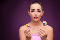 The beautiful woman with colourful lollipop Stock Photography