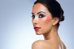 Beautiful woman with colourful makeup Stock Images