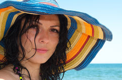Beautiful woman in colourful sunhat Stock Photos