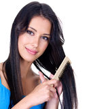 Beautiful woman with comb Stock Photo