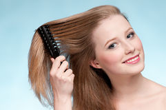Beautiful woman with comb Royalty Free Stock Images