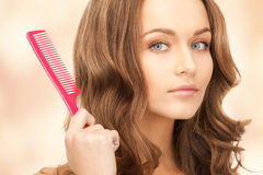 Beautiful woman with comb Royalty Free Stock Photo