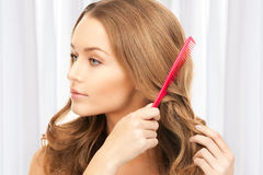 Beautiful woman with comb Stock Image