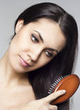 Beautiful woman with comb Stock Photography