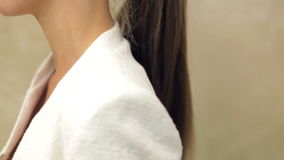 Beautiful woman combing her long hair, making ponytail stock video