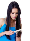 Beautiful woman combing long hair Royalty Free Stock Image