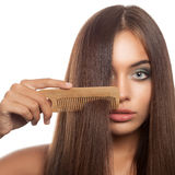 Beautiful woman combs her hair Royalty Free Stock Image