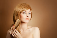 Beautiful Woman Combs Her Healthy Long Hair Royalty Free Stock Photos