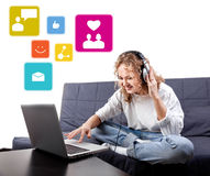 Beautiful woman communicate with people by means laptop Royalty Free Stock Images