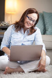 Beautiful woman with computer Royalty Free Stock Photos