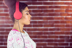 A beautiful woman concentrated on her music Royalty Free Stock Photo