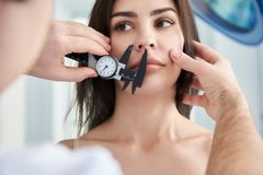 Beautiful woman during consultation with plastic surgeon royalty free stock image
