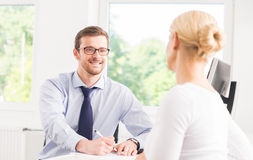 Beautiful woman consulting a man in the office Royalty Free Stock Photos