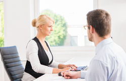Beautiful woman consulting a man in the office Stock Photography