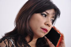 Beautiful woman conversation on mobile phone Stock Photography