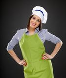 Beautiful woman cook standing akimbo Stock Photos