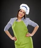 Beautiful woman cook standing akimbo Stock Photos