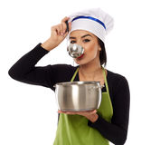 Beautiful woman cook tasting soup Stock Images