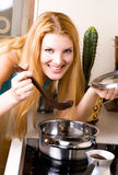 Beautiful woman cooking dinner Stock Image
