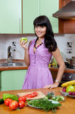 Beautiful woman cooking healthy food Stock Photo