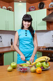 Beautiful woman cooking healthy food Royalty Free Stock Image