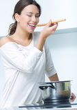 Beautiful woman cooking at the kitchen Stock Images