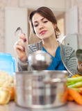 Beautiful woman cooking with ladle Royalty Free Stock Photos