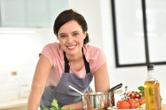 Beautiful woman cooking Stock Photography