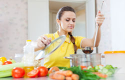 Beautiful woman cooking  vegetarian food Stock Image