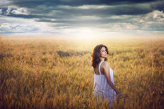 Beautiful woman in corn field with dramatic light Royalty Free Stock Photography
