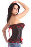 Beautiful woman in corset lingerie strikes pose Royalty Free Stock Photo