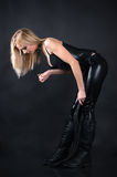 Beautiful woman in a corset with a whip. In hands Stock Photography