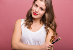 Beautiful woman with cosmetic brush. Beautiful woman beautician with cosmetic brushes Stock Photos