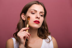 Beautiful woman with cosmetic brush. Beautiful woman beautician with cosmetic brushes Royalty Free Stock Photography
