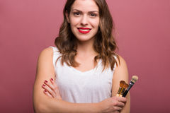 Beautiful woman with cosmetic brush. Beautiful woman beautician with cosmetic brushes Stock Photo
