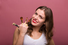 Beautiful woman with cosmetic brush. Beautiful woman beautician with cosmetic brushes Stock Photography